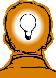 Human head with glowing lightbulb inside
