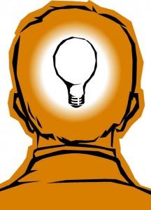 Human head with glowing lightbulb inside